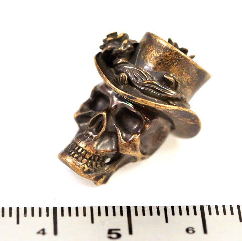 "Valokuva #7 Lanyard Bead ""Skull in hat"" (bronze)"