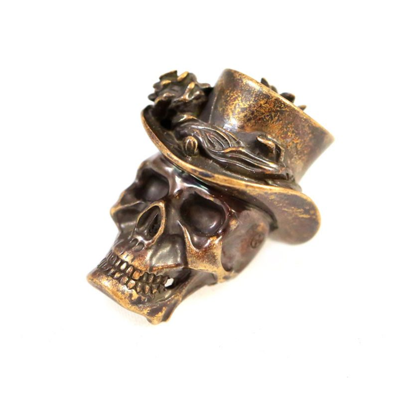 "Valokuva #2 Lanyard Bead ""Skull in hat"" (bronze)"